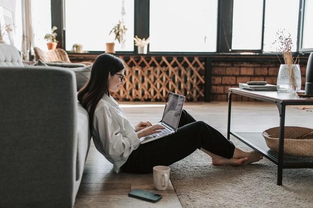 A woman looking at a computer.
