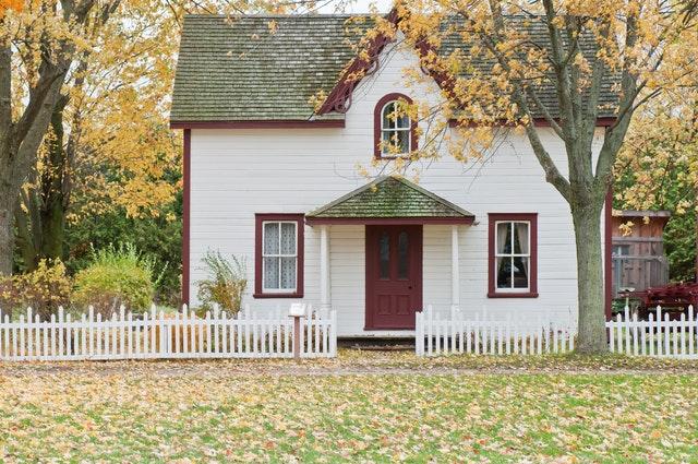 lovely white house in fall