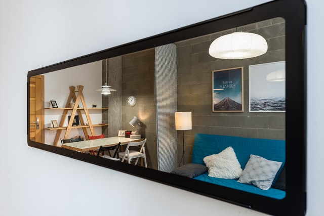 A mirror in a small living room.