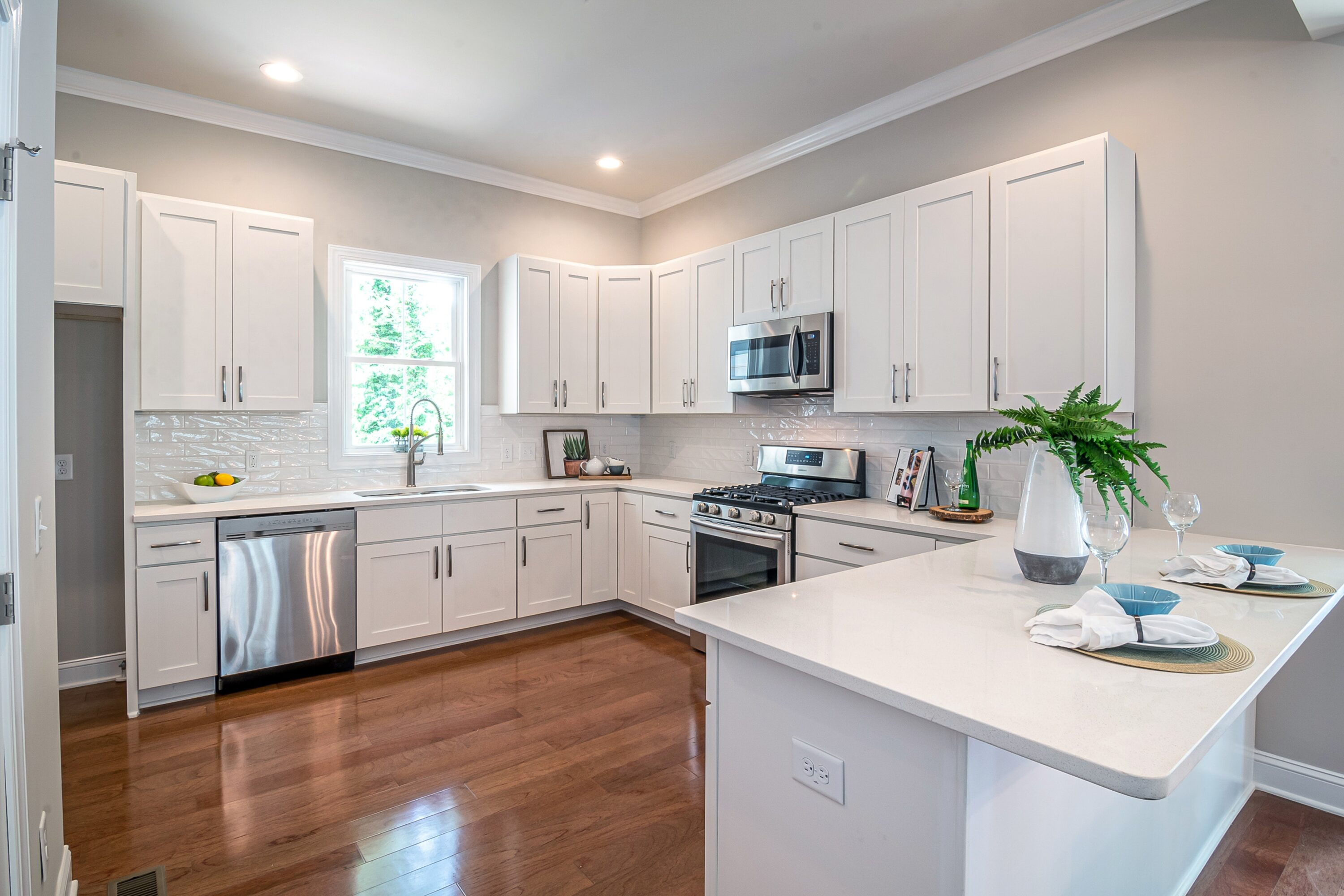 A beautiful new kitchen with white cabinets