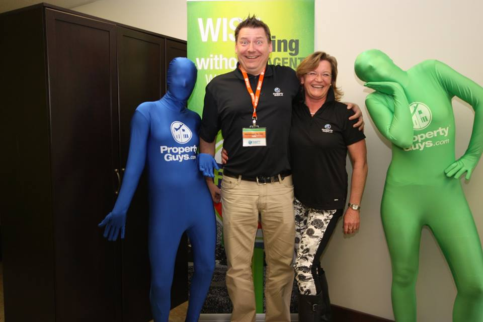 Chistoph and Birgit Braier with PropertyGuys.com morph suits