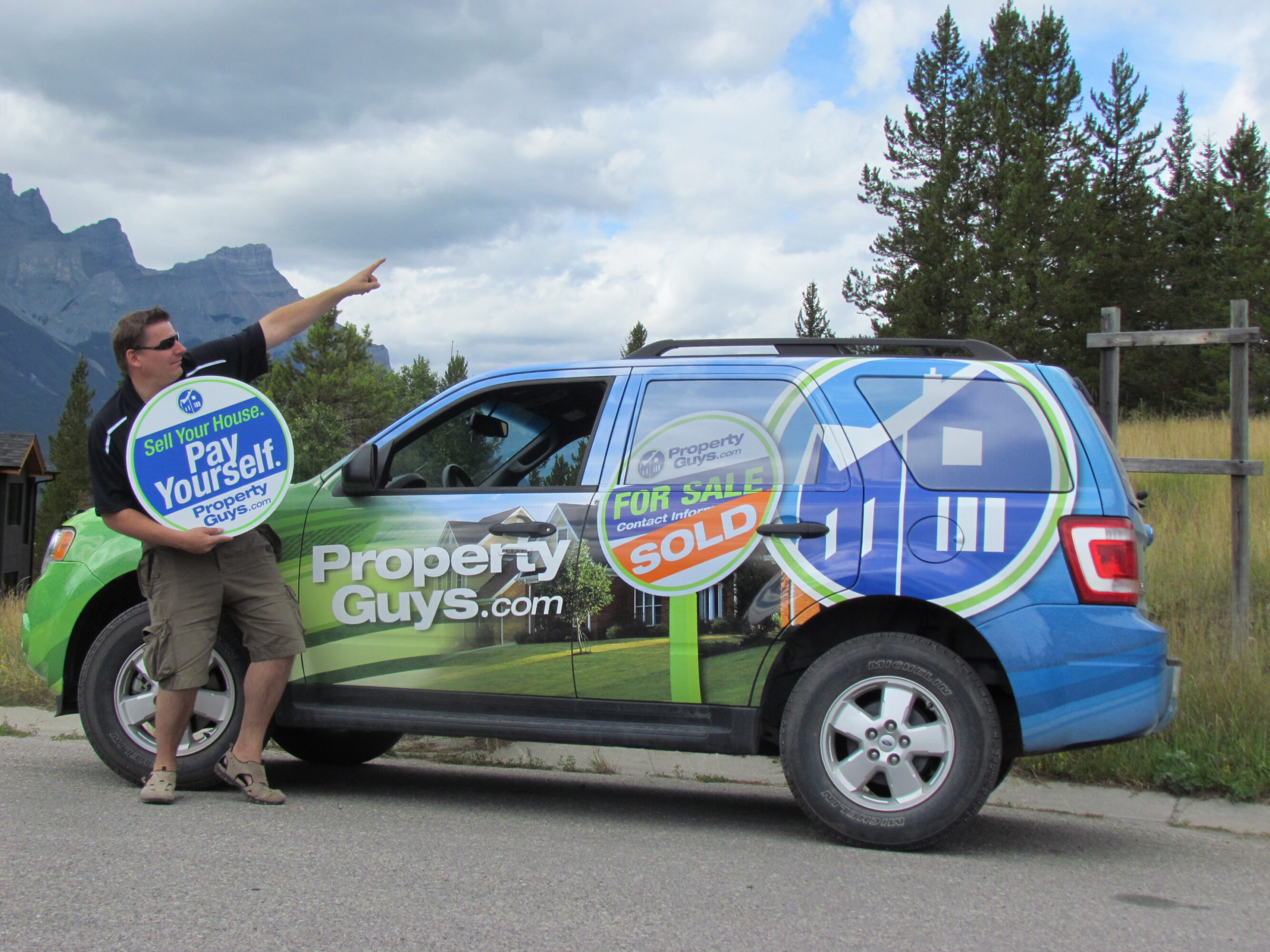 Christoph Braier with wrapped PropertyGuys.com vehicle