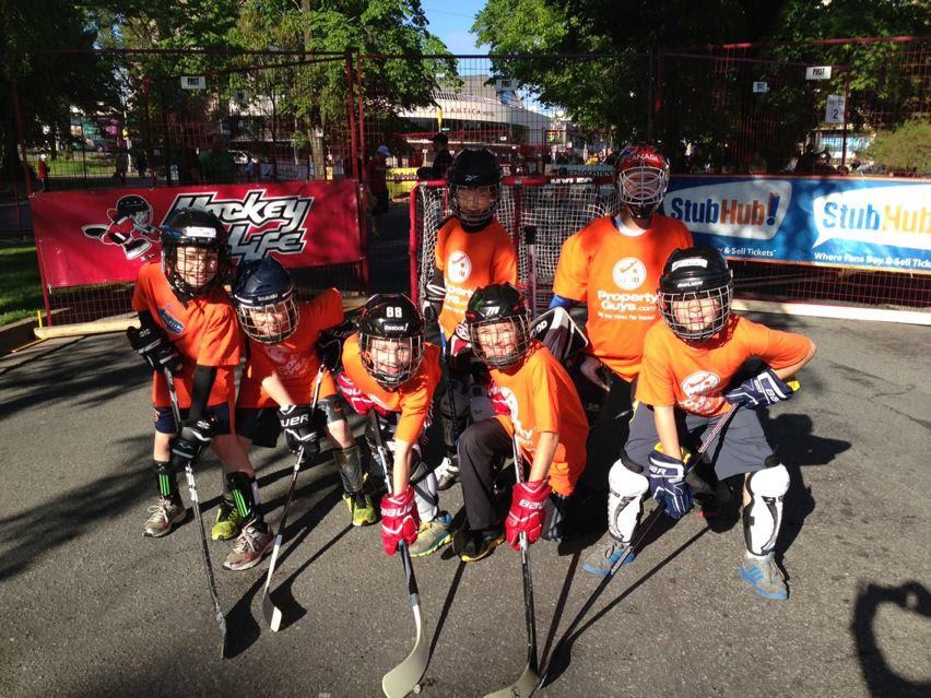 Kids playing street hockey