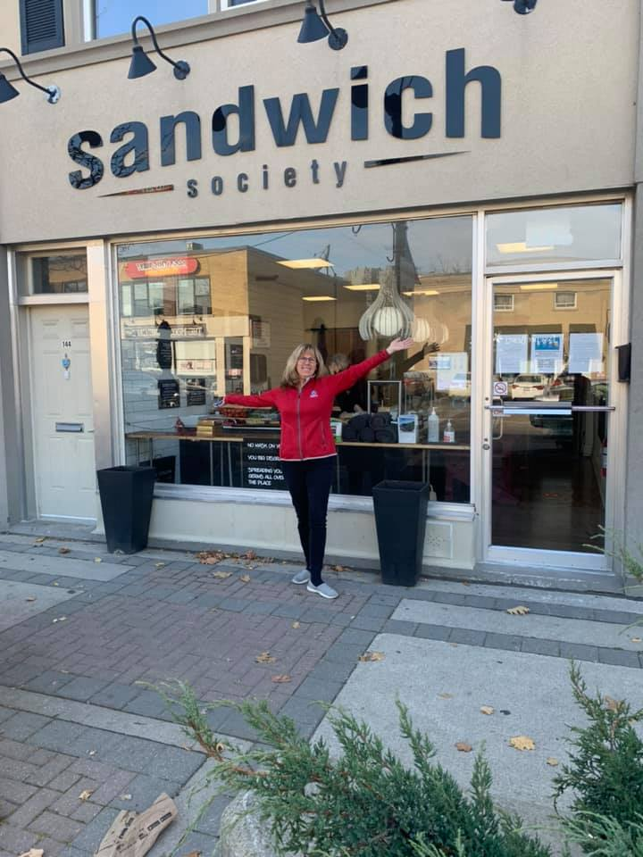 Kim Marshall in front of Sandwich Society
